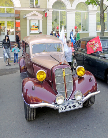 zinnwaldite brown: Soviet retro frontengine rearwheeldrive passenger car of 193040s sedan GAZ M1 Emka with foglight