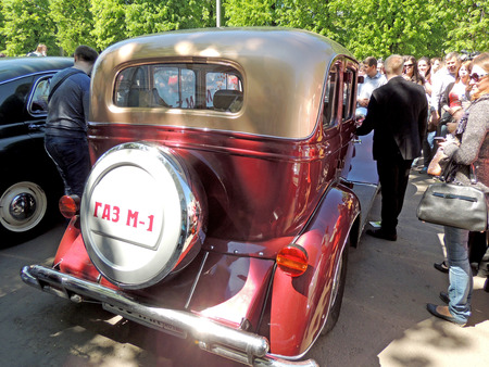 zinnwaldite brown: Back view of Soviet retro frontengine rearwheeldrive passenger car of 193040s sedan GAZ M1 Emka