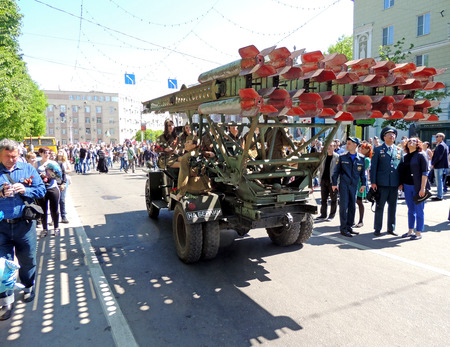 ve: City dwellers look round retro car Katyusha multiple rocket launcher of Red Army World War II on the city central square during the celebration of Victory VE Day Editorial