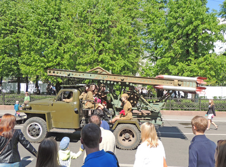 ve: Girls in uniform on the retro car Katyusha multiple rocket launcher of Red Army World War II on the city central square during the celebration of Victory VE Day Editorial