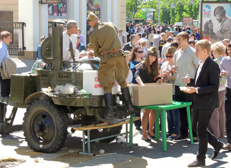 ve: City dwellers taste army food prepared by field kitchen during the celebration of Victory VE Day