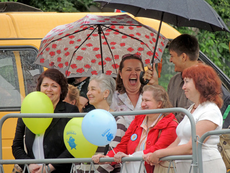 conviviality: Roar of laughter of spectacles in the wet day. Music Festival of Children39s Brass Bands in the city square.