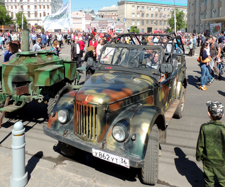 ve: Retro car of 195070s soviet military allwheeldrive light truck jeep UAZ69 GAZ69 and army mobile kitchen on the city square during the celebration of Victory VE Day Editorial