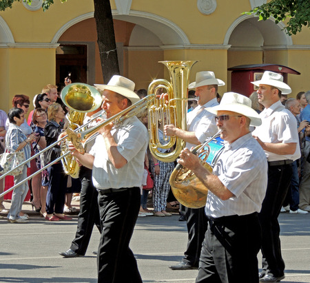 brass  band: Brass band on the avenue. Parade of Street Theatres on the Platonov Arts Festival Editorial