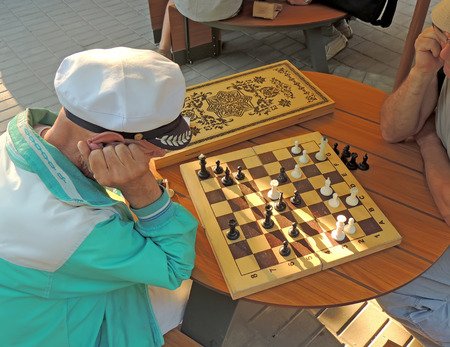 mature men: Two mature men playing chess