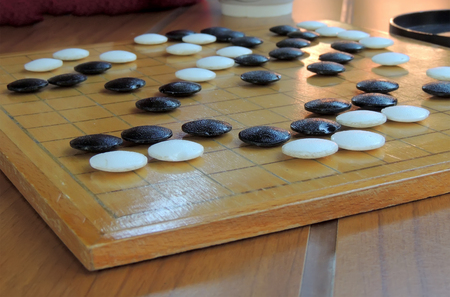 mind game: Board game Go or Weiqi; or way-chee; or Igo; or Paduk; or Baduk;