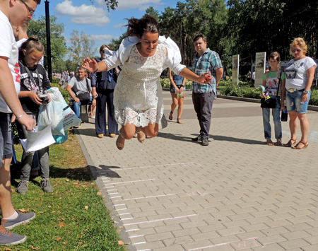tree dweller: Townspeople watch the long jumps for all comers at the festival Healthy Voronezh on the city park Editorial