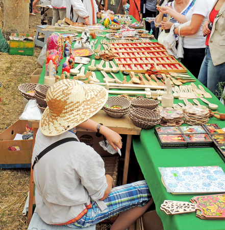 garden city: Street stall vendor of handicraft cookware with a straw on the city square during the international exhibition-fair Voronezh - Garden City