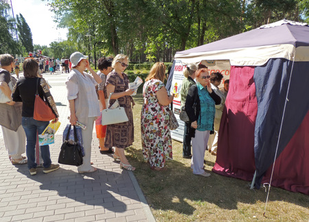 grass plot: Senior women expect a queue to check vision and health at the festival Healthy Voronezh in the city park Editorial