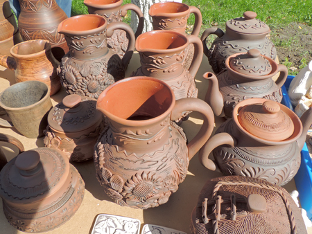 market stall: Market stall with earthenware pots, teapots, mugs and another ceramics