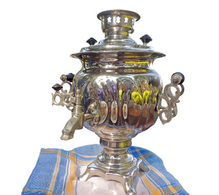 party food: Russian samovar for tea drinking with tablenapkin isolated