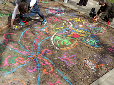tantric: The creation of a sand mandala in a ground at the opening of Indian goods store