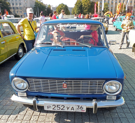 nicknamed: Townspeople consider compact sedan soviet retrocar VAZ-2101 commonly nicknamed Zhiguli during the parade of the vintage cars on the city central square