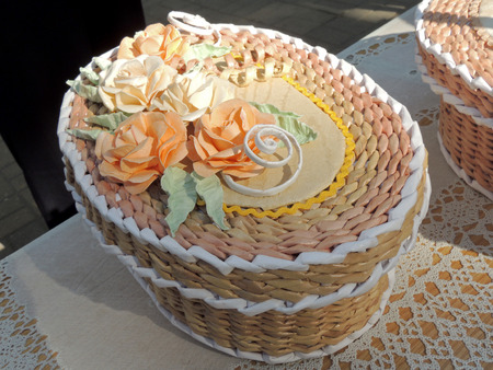 wicker work: Oval handicraft paper box decorated with roses Stock Photo