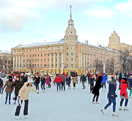 iceskating: Ice-skating the townspeople in the central square of the city