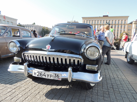 sidelight: Front element of soviet executive car of 1960s sedan GAZ M21 Volga the Second Series Shark at the vintage car parade on the city central square