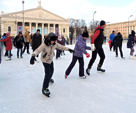 urbanite: Ice-skating the townsfolk near city opera house in the city core Editorial