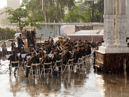 brass  band: Military brass band perform during a shower. Central Avenue in the Park of VDNH, Moscow. International Military Music Festival Spasskaya Tower. Editorial