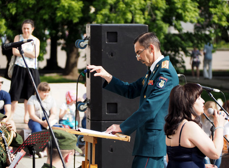 aerophone: Band-master and singer during a performance on the Central Avenue in the Park of VDNH, Moscow. International Military Music Festival Spasskaya Tower. Editorial