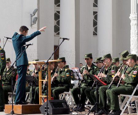 aerophone: Band-master during a performance. Central Avenue in the Park of VDNH, Moscow. International Military Music Festival Spasskaya Tower.