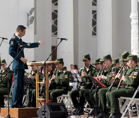 aerophone: Band-master during a performance. Central Avenue in the Park of VDNH, Moscow. International Military Music Festival Spasskaya Bashnya. Editorial