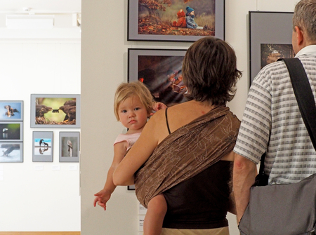 elementary age girl: Family with elementary age girl in a gallery. Classic Photo Gallery. Russian Week Of Photography 2016 Editorial