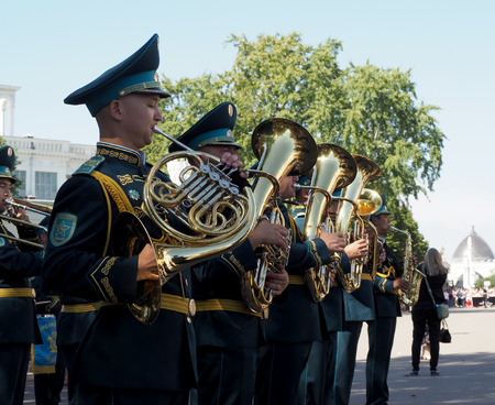 french horn: French horn and tuba rank in brass band of Kazakhstan. Festival of military orchestras Spasskaya Tower. Central Avenue in the Park of VDNH, Moscow.