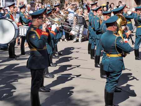 aerophone: Rank trombonists in military band of Russia. Festival of military orchestras Spasskaya Tower. Central Avenue in the Park of VDNH, Moscow.
