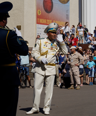 aerophone: Bandmaster of brass band from Kazakhstan asks the audience what musical composition to execute. Festival of military orchestras Spasskaya Tower. Central Avenue in the Park of VDNH, Moscow.