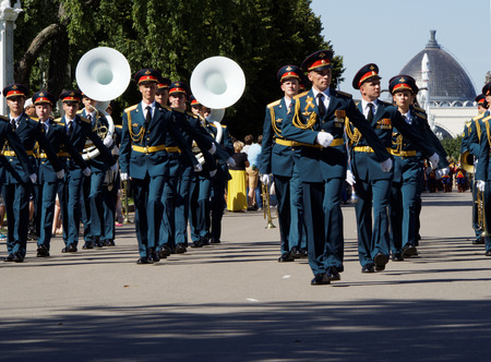 aerophone: Military brass band of Russia marches. Festival of military orchestras Spasskaya Tower. Central Avenue in the Park of VDNH, Moscow.