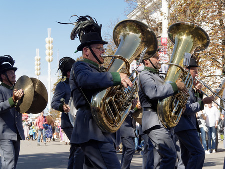 aerophone: Musicians of the Orchestra of the Tyrolean Imperial Riflemen, Austria. Festival of military orchestras Spasskaya Tower. Central Avenue in the Park of VDNH, Moscow.