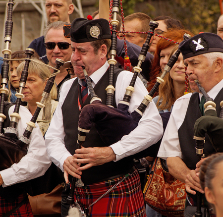 aerophone: Pipers of Celtic pipes and drums band surrounded by townspeople in the Park of arts Muzeon on the Crimean embankment, Moscow. Festival of military orchestras Spasskaya Tower. Editorial