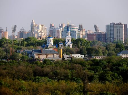 Church of Vladimir Equal to the Apostles on the background of city buildings in Voronezh, Russia