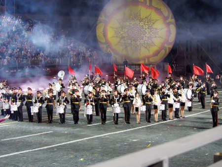 Moscow, Russia - Aug 25, 2017: Night performance of trumpet players and drummers at the festival of military orchestras Editöryel
