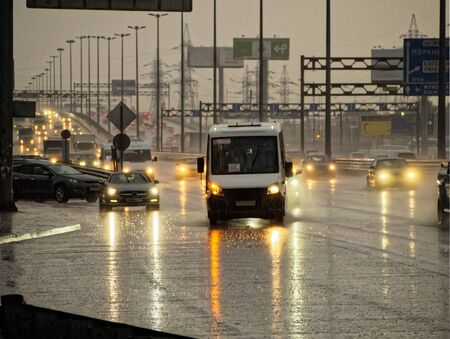 City highway in the evening with cars during the rain
