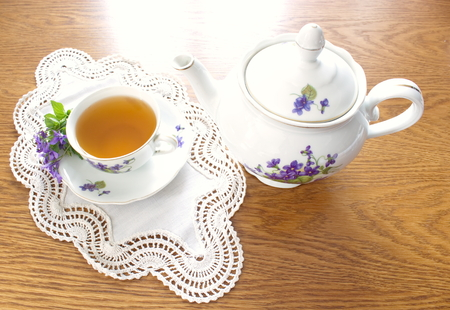 tea service: Old china tea service with bouquet of violets Stock Photo