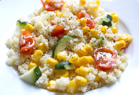 free dish: couscous served with zucchini and tomatoes corns