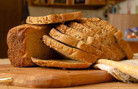 whole wheat: Fresh whole wheat bread slices on a wooden Stock Photo