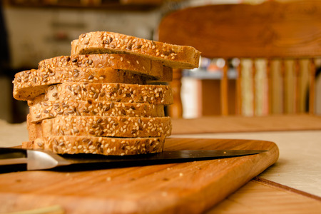 whole wheat bread: Fresh whole wheat bread slices on a wooden Stock Photo