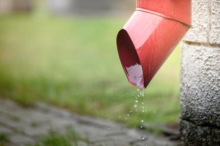 Rainwater flows out of the drainpipe Foto de archivo