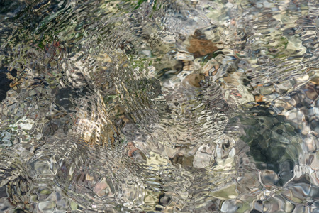 Ripples on the water, transparent river water and reefs - a natural texture Stok Fotoğraf