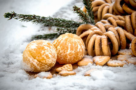 Mandarins, snow, spruce branches - Christmas background and concept of the new composition