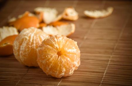 Mandarin on a wooden table Stok Fotoğraf