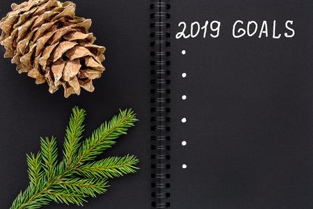 Christmas composition. Black open notepad. 2019 goals