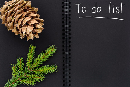 Christmas composition. Black open notepad to-do list