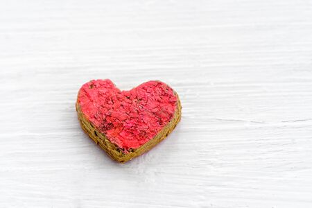 Red heart on white wooden background. Valentines day. Heart is a symbol of love. Stok Fotoğraf