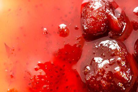 Background of strawberry jam, close-up