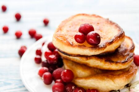 Pancakes with berries on a plate. Summer cottage delicacies