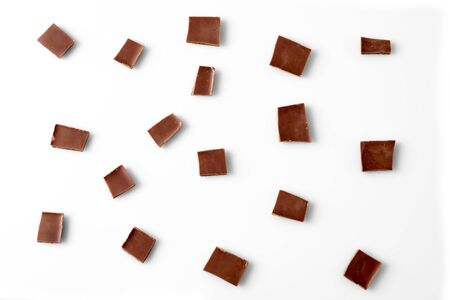 Chocolate slices on white background, top view Stok Fotoğraf - 128057099