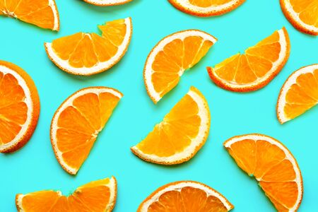 Fruit pattern of fresh orange slices on green background. Stok Fotoğraf